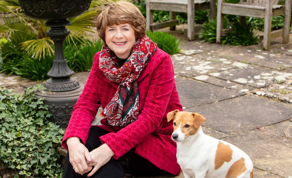 Pam Ayres sat in the garden